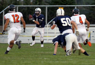 Sarah Nader - snader@shawmedia.com Cary-Grove's Ryan Mahoney runs a play during the first quarter of Friday's game against St. Charles East in Cary on August 24, 2012. Cary-Grove won, 49-33.
