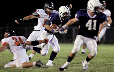 Sarah Nader - snader@shawmedia.com Cary-Grove's Ryan Mahoney runs down field to score a touchdown during the third quarter of Friday's game against St. Charles East in Cary on August 24, 2012. Cary-Grove won, 49-33.