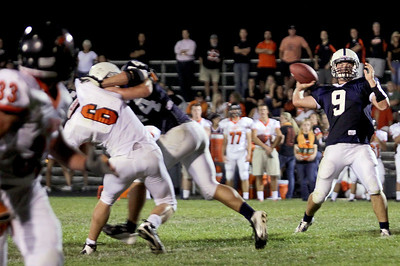 Sarah Nader - snader@shawmedia.com Cary-Grove's quarterback Quinn Baker throws a pass during the third quarter of Friday's game against St. Charles East in Cary on August 24, 2012. Cary-Grove won, 49-33.