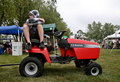Josh Peckler - Jpeckler@shawmedia.com Justin Chrisman, 13 of Ringwood sits on a tracker during the Annual Ringwood Picnic at the Ringwood Village Hall Sunday, August 26. 2012. Although rain was in the forecast residents still came out to enjoy the food and other activities in Ringwood.