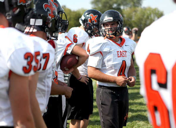 St. Charles East defensive lineman Sam Malone (4) is taking the lead in the Saints' defensive front.