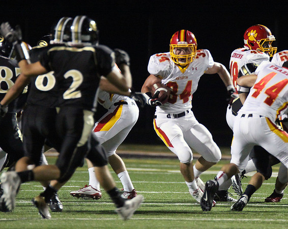 Jeff Krage – For the Kane County Chronicle<br /> Batavia's Robert Bowman returns a kickoff during Friday's game at Glenbard North.<br /> Carol Stream 8/24/12