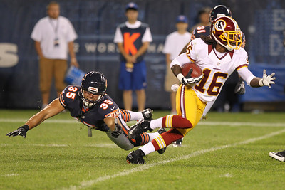 Mike Greene - mgreene@shawmedia.com The Bears' Brandon Hardin dives after Redskins returner Brandon Banks during a preseason game Saturday, August 18, 2012 at Soldier Field in Chicago. Banks took the kick all the way to the endzone for a touchdown.