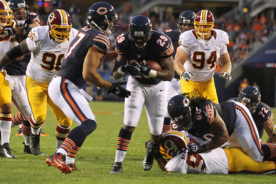 Mike Greene - mgreene@shawmedia.com Bears running back Michael Bush crosses the endzone for a touchdown in the first half of a preseason game against the Washington Redskins Saturday, August 18, 2012 at Soldier Field in Chicago.