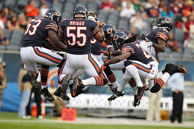 Mike Greene - mgreene@shawmedia.com Bear linebacker Lance Briggs jumps in the air with teammates before the start of a preseason game against the Washington Redskins Saturday, August 18, 2012 at Soldier Field in Chicago.