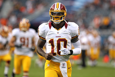 Mike Greene - mgreene@shawmedia.com Redskins QB Robert Griffin III leads his team onto the field before a preseason game against the Bears Saturday, August 18, 2012 at Soldier Field in Chicago.