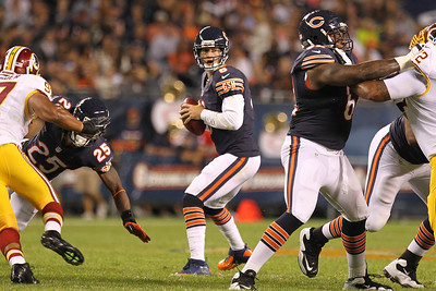 Mike Greene - mgreene@shawmedia.com Bears quarterback Jay Cutler looks downfield for an open receiver during a preseason game against the Washington Redskins Saturday, August 18, 2012 at Soldier Field in Chicago.