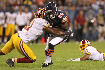 Mike Greene - mgreene@shawmedia.com Bears wide receiver Earl Bennett is hit by Redskins safety Madieu Williams during a preseason game Saturday, August 18, 2012 at Soldier Field in Chicago.