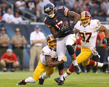 Mike Greene - mgreene@shawmedia.com Bears wide receiver Alshon Jeffery gets is wrapped up by a defender after a reception during a preseason game against the Washington Redskins Saturday, August 18, 2012 at Soldier Field in Chicago.
