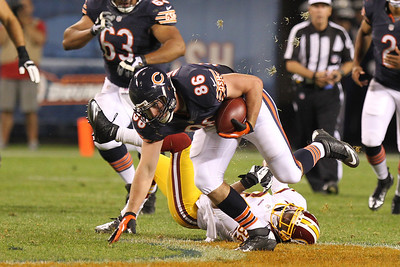 Mike Greene - mgreene@shawmedia.com Bears tight end Kyle Adams catches his balance after a catch during a preseason game against the Washington Redskins Saturday, August 18, 2012 at Soldier Field in Chicago.