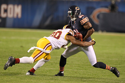 Mike Greene - mgreene@shawmedia.com Bears wide receiver Rashied Davis is hit by Redskins cornerback Cedric Griffin during a preseason game Saturday, August 18, 2012 at Soldier Field in Chicago.