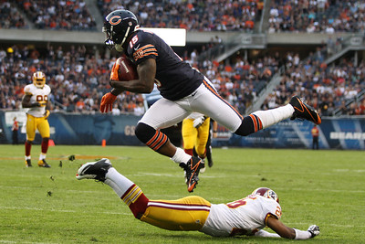 Mike Greene - mgreene@shawmedia.com Bear wide receiver Brandon Marshall hurdles a defender during a preseason game against the Washington Redskins Saturday, August 18, 2012 at Soldier Field in Chicago.