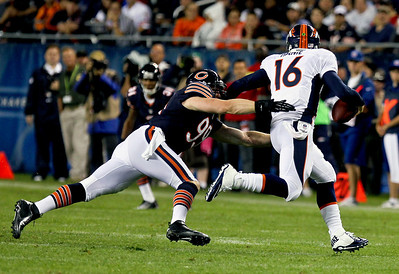 Sarah Nader - snader@shawmedia.com Chicago Bears' Shea McClellin (left) tackles Denver's quarterback Caleb Hanie during the second quarter of Thursday's pre-season game at Soldier Field in Chicago on August 9, 2012.