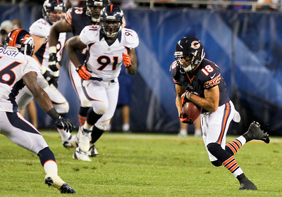 Sarah Nader - snader@shawmedia.com Chicago Bears'  Dane Sanzenbacher runs the ball during the second quarter of Thursday's pre-season game against the Denver Broncos at Soldier Field in Chicago on August 9, 2012.