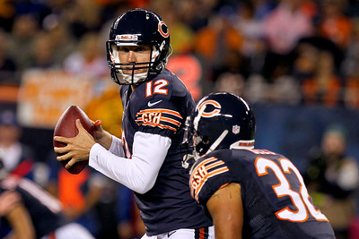 Sarah Nader - snader@shawmedia.com Chicago Bears' quarterback Josh McCown passes off the ball during the second quarter of Thursday's pre-season game against the Denver Broncos at Soldier Field in Chicago on August 9, 2012.