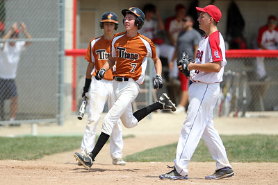 Mike Greene - mgreene@shawmedia.com Lyons Township Titans' Kevin Kotil passes by Crystal Lake Cardinals' Vinny Rottuno to score after a passed ball during a MCYSA Summer International Championship game Thursday, August 2, 2012 at Marian Central Catholic High School in Woodstock. The Titans defeated the Cardinals 7-6.