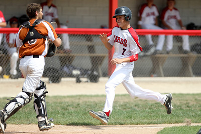 Mike Greene - mgreene@shawmedia.com Crystal Lake Cardinals' Aaron Braun attempts to avoid contact with Lyons Township Titans' catcher Nick Gron during a MCYSA Summer International Championship game Thursday, August 2, 2012 at Marian Central Catholic High School in Woodstock. The Titans defeated the Cardinals 7-6.
