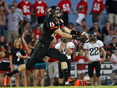 Brett Moist / For the Northwest Herald Crystal Lake Central's Isaiah Mosher catches a pass and completes a 73 yard touchdown run during the first quarter against Huntley at Crystal Lake Central High School on Friday.