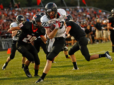 Brett Moist / For the Northwest Herald Huntley's Jake Lackovic runs past Crystal Lake Central's Brent Pfaff to score the second Huntley touchdown during the first quarter  at Crystal Lake Central High School on Friday.