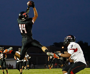 Brett Moist / For the Northwest Herald Crystal Lake Central's Andrew Alexander catches a pass during the second quarter of gameplay at Crystal Lake Central High School on Friday. Huntley's Damario Hughes defends.