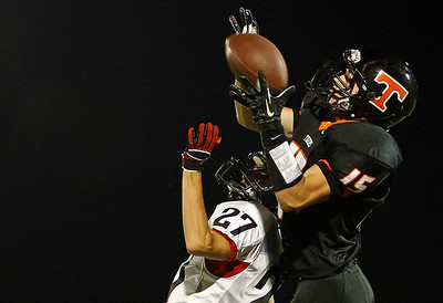 Brett Moist / For the Northwest Herald Crystal Lake Central's Isaish Mosher (15) catches a pass over Huntley's Josh Sepsey during the third quarter in the game at Crystal Lake Central High School on Friday.