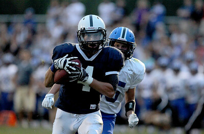 Sarah Nader - snader@shawmedia.com Cary-Grove's Ryan Mahoney catches a 36 yard pass to score a touchdown during the first quarter of Friday's game against Lake Zurich on August 31, 2012. Cary-Grove won, 21-6.