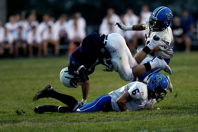 Sarah Nader - snader@shawmedia.com Cary-Grove's Ryan Mahoney (center) is tackled by a Lake Zurich player during the second quarter of Friday's game in Cary on August 31, 2012. Cary-Grove won, 21-6.