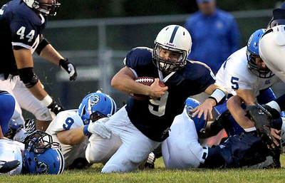 Sarah Nader - snader@shawmedia.com Cary-Grove's quarterback Quinn Baker is tackled during the second quarter of Friday's game against Lake Zurich on August 31, 2012. Cary-Grove won, 21-6.