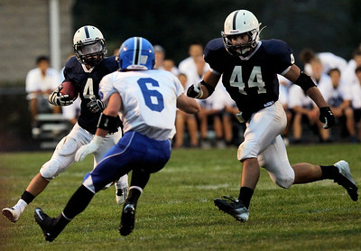 Sarah Nader - snader@shawmedia.com Cary-Grove's Ryan Mahoney (left) is tackled by Lake Zurich's Sean Lynch during the first quarter of Friday's game in Cary on August 31, 2012. Cary-Grove won, 21-6.