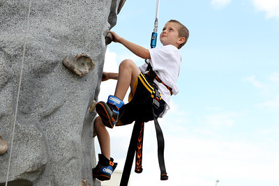 Mike Greene - mgreene@shawmedia.com Logan Mills, 8 of McHenry, focuses on his next hold while participating in a free wall climbing event during SportsFest 2012 Sunday, August 19, 2012 in Cary. The annual sports and fitness showcase, sponsored by the Cary Grove Area Chamber of Commerce, featured over 50 area vendors and demonstrations throughout the event from local groups.