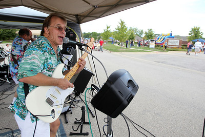 Mike Greene - mgreene@shawmedia.com Scott Jensen, of Echoes of Time, sings for participants at SportsFest 2012 Sunday, August 19, 2012 in Cary. The annual sports and fitness showcase, sponsored by the Cary Grove Area Chamber of Commerce, featured over 50 area vendors and demonstrations throughout the event from local groups.