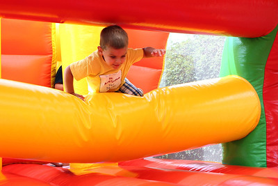 Mike Greene - mgreene@shawmedia.com Benjamin Bernstein, 3 of Cary, climbs over an obstacle in a bounce house during SportsFest 2012 Sunday, August 19, 2012 in Cary. The annual sports and fitness showcase, sponsored by the Cary Grove Area Chamber of Commerce, featured over 50 area vendors and demonstrations throughout the event from local groups.