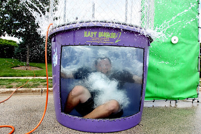 Mike Greene - mgreene@shawmedia.com Ryan Slattery, a Cary-Grove High School teacher and football coach, splashes into a dunk tank during SportsFest 2012 Sunday, August 19, 2012 in Cary. The annual sports and fitness showcase, sponsored by the Cary Grove Area Chamber of Commerce, featured over 50 area vendors and demonstrations throughout the event from local groups.