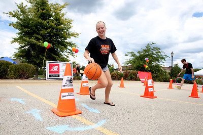 Mike Greene - mgreene@shawmedia.com Cassidy Belpedio, 13 of McHenry, rounds a cone on an obstacle course during SportsFest 2012 Sunday, August 19, 2012 in Cary. The annual sports and fitness showcase, sponsored by the Cary Grove Area Chamber of Commerce, featured over 50 area vendors and demonstrations throughout the event from local groups.