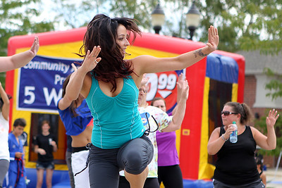 Mike Greene - mgreene@shawmedia.com Zumba instructor Jessica Beuckman, of Lake in the Hills, participates in a flash mob during SportsFest 2012 Sunday, August 19, 2012 in Cary. The annual sports and fitness showcase, sponsored by the Cary Grove Area Chamber of Commerce, featured over 50 area vendors and demonstrations throughout the event from local groups.