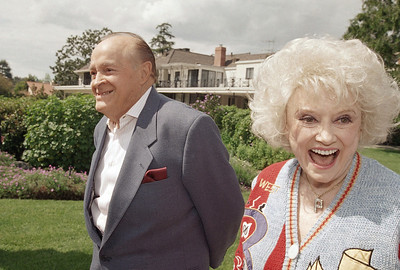 In this March 22, 1995 file photo Entertainers Bob Hope and Phyllis Diller share a laugh at Hope's estate in the Toluca Lake area in Los Angeles. (AP Photo/ Damian Dovarganes)