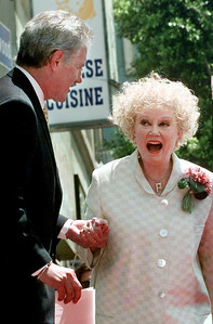 In this May 17, 1999 file photo, Emmy award winning game show host, Alex Trebek greets actress and comedian Phyllis Diller before receiving his newly-dedicated star on the Hollywood Walk of Fame in the Hollywood section of Los Angeles. Diller, the housewife turned humorist who aimed some of her sharpest barbs at herself, died Monday, Aug. 20, 2012, at age 95 in Los Angeles. (AP Photo/Nick Ut, File)
