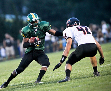 Josh Peckler - Jpeckler@shawmedia.com Crystal Lake South's Zevin Clark (1) tries to fake out Crystal Lake Central's Justin Ellman during the first quarter at Crystal Lake South Friday, August 31, 2012.