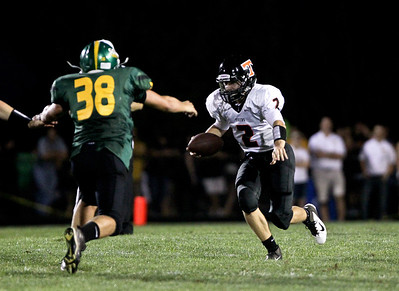 Josh Peckler - Jpeckler@shawmedia.com Crystal Lake Central quarterback Kyle Lavand (2) scrambles away from Crystal Lake South's John Fitzpatrick  during the second quarter at Crystal Lake South Friday, August 31, 2012.