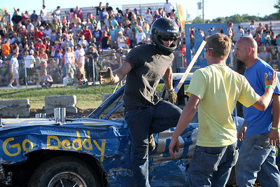 "Mike Greene - mgreene@shawmedia.com D8 driver Wes Quick celebrates after winning the ""Icon"" portion of the Demoliton Derby competition at the McHenry County Fair Sunday, August 5, 2012 in Woodstock."