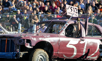 "Mike Greene - mgreene@shawmedia.com 512 driver Nate Kestlyn, of Garden Prairie, raises his hand before the start of the ""Icon"" heat of the Demoliton Derby competition at the McHenry County Fair Sunday, August 5, 2012 in Woodstock."