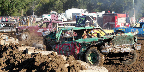 "Mike Greene - mgreene@shawmedia.com 17 driver Greg Sker, of Marengo, peels down the track during the ""Icon"" heat of the Demoliton Derby competition at the McHenry County Fair Sunday, August 5, 2012 in Woodstock."