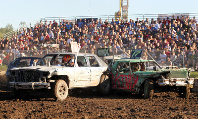"Mike Greene - mgreene@shawmedia.com 71 driver Andy Del, of Burlington WI, backs into 17 driver Greg Sker, of Marengo, during the ""Icon"" heat of the Demoliton Derby competition at the McHenry County Fair Sunday, August 5, 2012 in Woodstock."