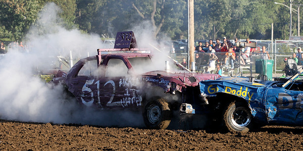"Mike Greene - mgreene@shawmedia.com Car 512 driven by Nate Kestlyn, of Garden Prairie, is enveloped in smoke after being hit during the ""Icon"" heat of the Demoliton Derby competition at the McHenry County Fair Sunday, August 5, 2012 in Woodstock."