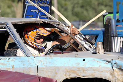"Mike Greene - mgreene@shawmedia.com Andy Del, of Burlington WI, gives the thumbs up before the start of the ""Icon"" heat of the Demoliton Derby competition at the McHenry County Fair Sunday, August 5, 2012 in Woodstock."