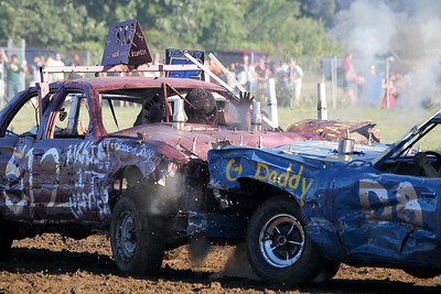 "Mike Greene - mgreene@shawmedia.com 512 driver Nate Kestlyn, of Garden Prairie, reacts while being hit by the D8 car during the ""Icon"" portion of the Demoliton Derby competition at the McHenry County Fair Sunday, August 5, 2012 in Woodstock. Kestlyn took second place in the competition."