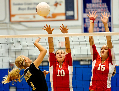 Josh Peckler - Jpeckler@shawmedia.com Dundee-Crown's Cori Eischen (10) and Kathryn Novy (16) attempt to block Streamwood's Tawny Carroll during the 2nd game at Dundee-Crown High School Wednesday, August 22, 2012. Dundee-Crown won the match 2-1.