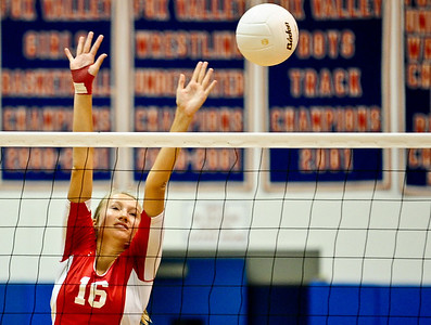 Josh Peckler - Jpeckler@shawmedia.com Dundee-Crown's Kathryn Novy attempts to block the ball during the 2nd game against Streamwood at Dundee-Crown High School Wednesday, August 22, 2012. Dundee-Crown won the match 2-1.