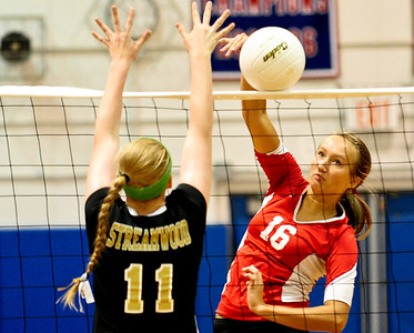 Josh Peckler - Jpeckler@shawmedia.com Dundee-Crown's Kathryn Novy (16) hits the ball past Streamwood's Hannah McGlone during the 1st game at Dundee-Crown High School Wednesday, August 22, 2012. Dundee-Crown won the match 2-1.