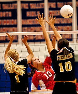 Josh Peckler - Jpeckler@shawmedia.com Dundee-Crown's Cori Eischen (10) attacks the ball in between Streamwood blockers Tawny Carroll (1) and Lexi Engram (10) during the 2nd game at Dundee-Crown High School Wednesday, August 22, 2012. Dundee-Crown won the match 2-1.